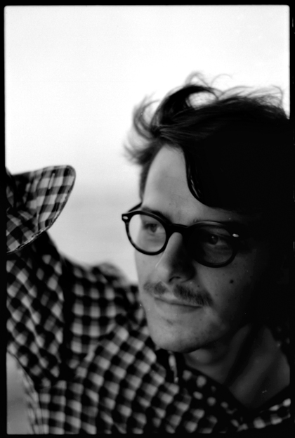 portrait of man with glasses black and white on film